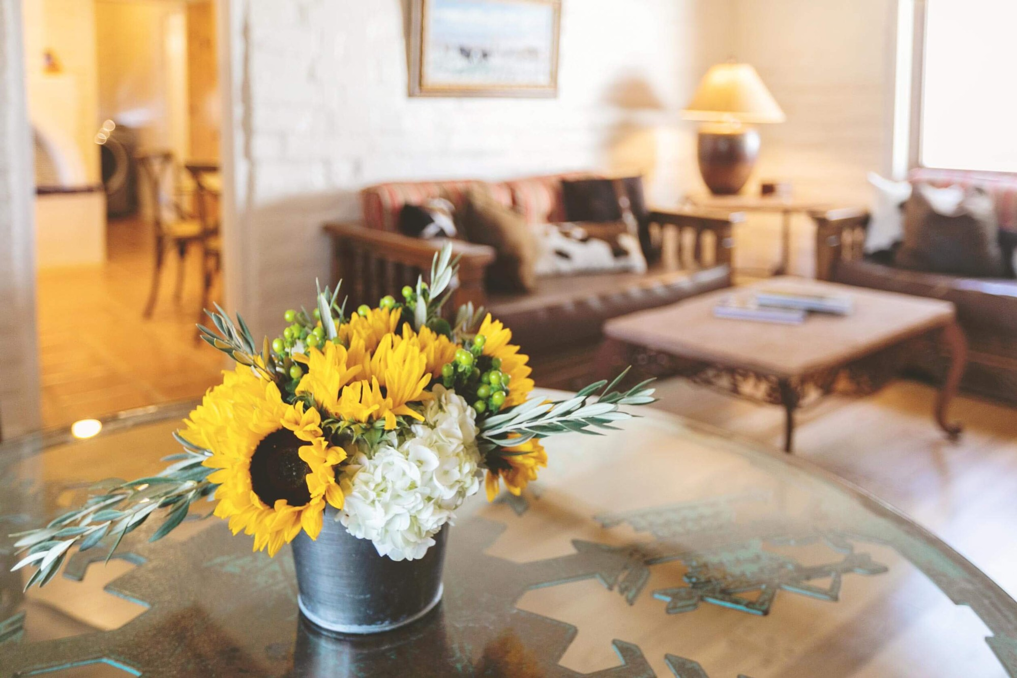 Sunflowers on a table in a mission-style living room.